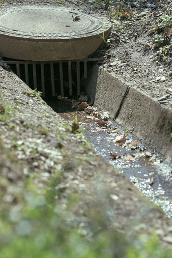 High angle view of water flowing through concrete wall