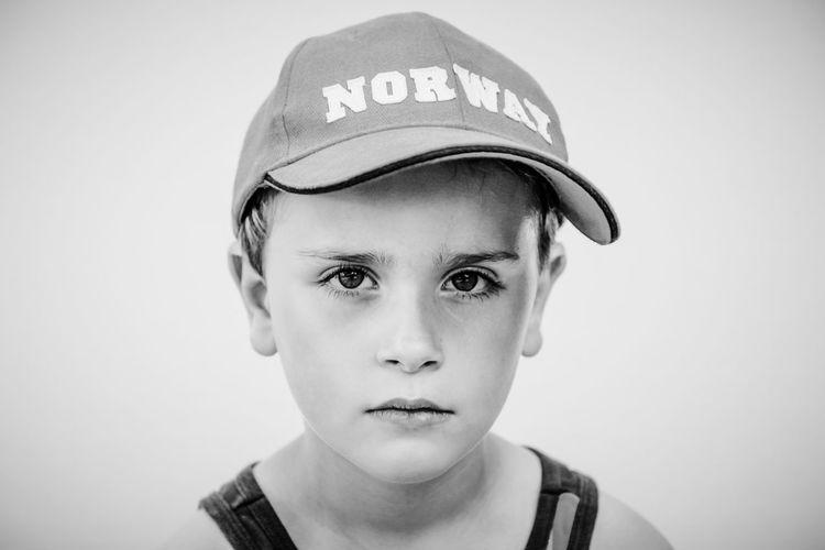 Close-up portrait of boy wearing cap