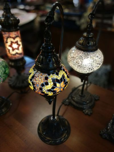 High angle view of antique electric lamps on table at store