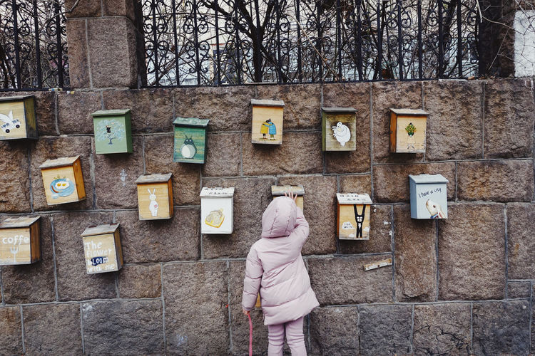 Child Standing Wall One Person Day Communication Warm Clothing Tree Outdoors Wall - Building Feature Streetphotography Street Kids Pink Color Letterbox Childhood Building Exterior Architecture Life City City Life Old Town