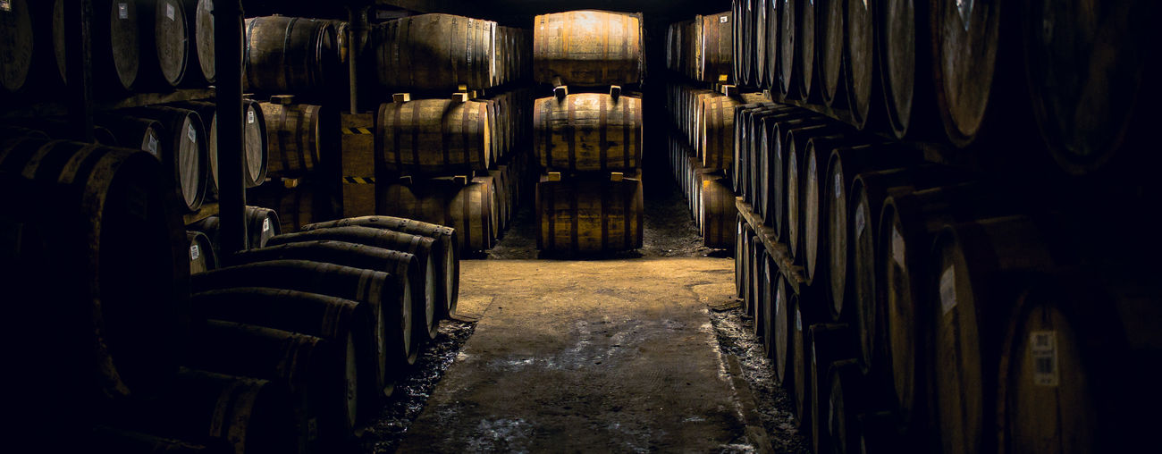 The Whisky is sleeping. Racks of casks with slowly maturing whiskey in the warehouses of Bruichladdich distillery on Islay, Scotland. Taken during a tour of the distillery in September 2015. Barrels Bruichladdich Casks Diminishing Perspective Illuminated Nature No People Side By Side Storage Warehouse Whisky Whisky Barrels Wood - Material