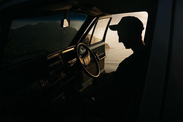Silhouette man in car