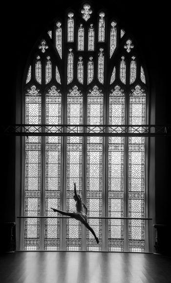 Ballet dancer in front of window