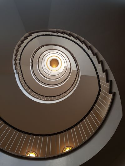 Golden Spiral Staircase Steps And Staircases Spiral Steps Staircase Railing High Angle View Circle Architecture Built Structure Hand Rail Turning Stairs Ceiling Light  Spiral Stairs Design Continuity vanishing point Diminishing Perspective