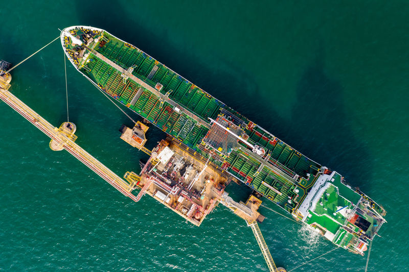High angle view of shipping oil and gas loading terminal on green sea