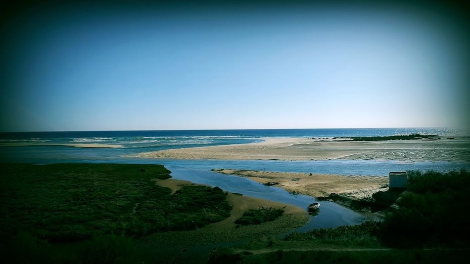 Sea Beach Water Clear Sky Tranquil Scene Outdoors Landscape No People Travel Destinations Blue Horizon Over Water Beauty In Nature Cacela Velha Portugal Looking At Camera