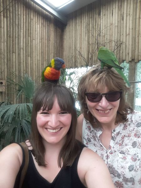 Bird Perches West Midlands Safari Park Mother Daughter Parrot Bird On Head Smiling Portrait Friendship Young Women Togetherness Headshot Happiness Fun Looking At Camera Mid Adult