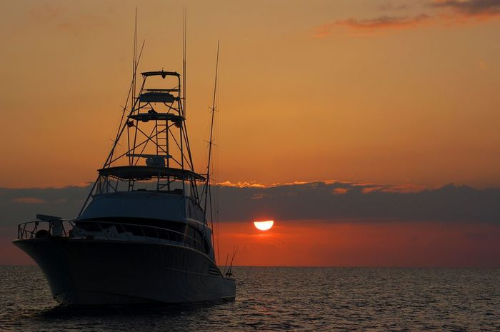 Beauty In Nature Big Game Fishing Day Day Is Done Deep Sea Fishing Horizon Over Water Luxury Mast Nature Nautical Vessel No People Outdoors Scenics Sea Sky Sunset Tranquil Scene Tranquility Transportation Water