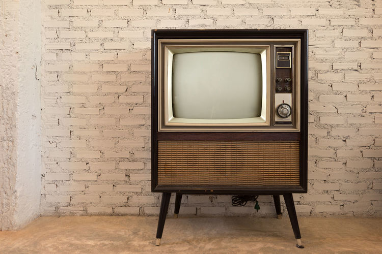Retro old television in vintage white wall background 60s 70s Antique Room Vintage Style Brick Wall Broadcast Broadcasting Class No People Obsolete Old Old-fashioned Retro Style Retro Styled Technology Television Television Industry Television Set The Media Tv