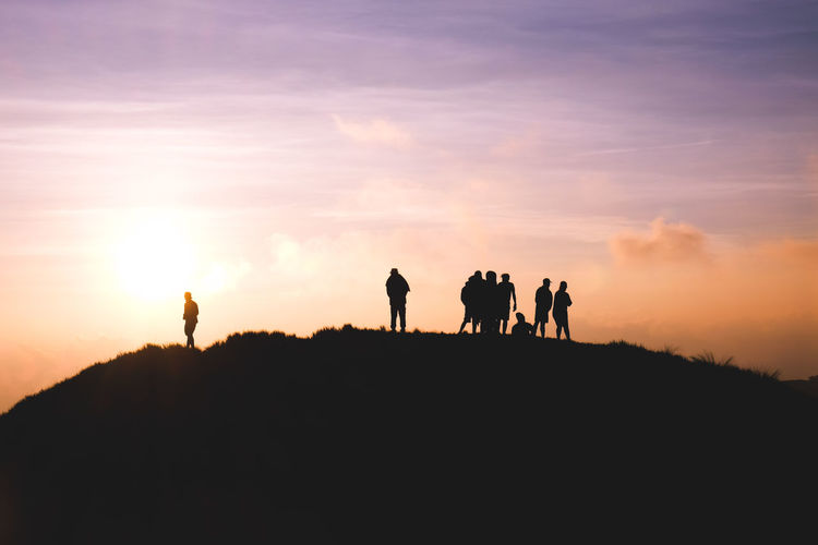 Silhouette Sunset Walking People Only Men Adult Adults Only Following Outdoors Sunlight Sky Hiking Rural Scene Togetherness Full Length Animal Themes Nature Day