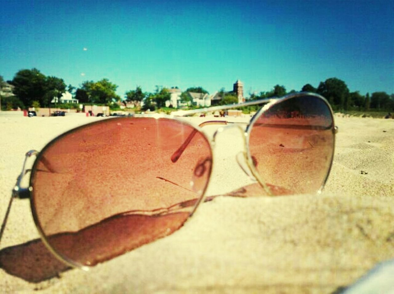 sunglasses, sand, reflection, beach, day, sky, no people, outdoors, sport, clear sky, close-up