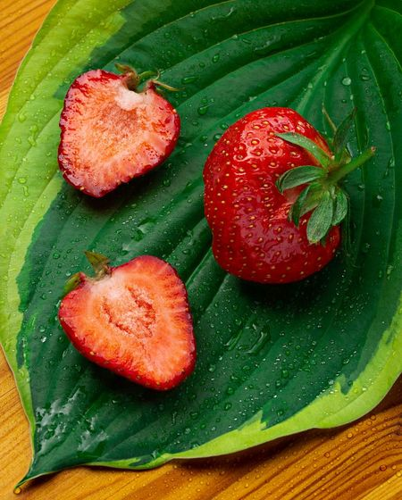 High angle view of strawberries on leaves