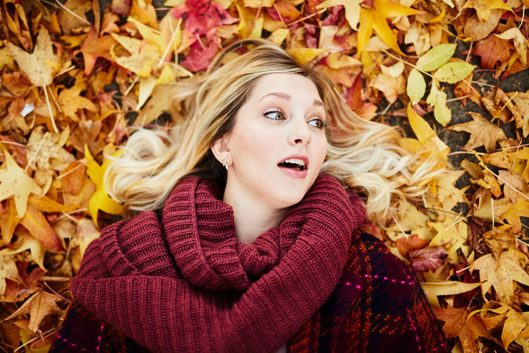 Adult Adults Only Autumn Beautiful Woman Beauty Beauty In Nature Blond Hair Change Dry Headshot Leaf Long Hair Maple Leaf Nature One Person One Woman Only One Young Woman Only Only Women People Scarf Studio Shot Sweater Yellow Young Adult Young Women