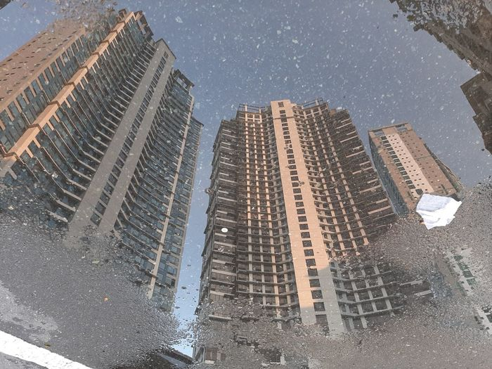 Reflection of buildings on wet glass