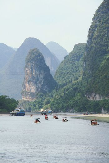 Boats and ferry in river