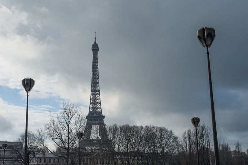 tower eiffel in Paris France Sky Architecture Built Structure Tower Cloud - Sky Travel Destinations Tall - High History City The Past Street Light Tourism Nature Travel Tree No People Metal Building Exterior Outdoors Iron - Metal Spire  France Paris Tower Eiffel Eiffel Tower Sky Grey