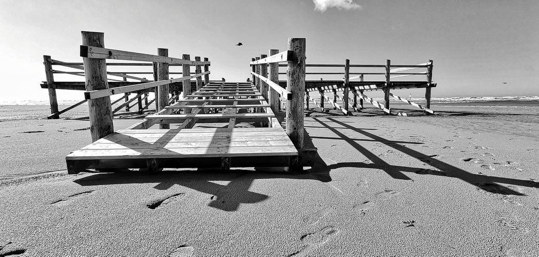 Seascape Sea And Sky Beach Photography Beach Day Wood Wooden Bridge No People Non-urban Scene Sky And Clouds Water Waterfront Black And White Sea Beach Wood - Material Sky Lifeguard Hut Lifeguard  Ocean Countryside Idyllic Tranquil Scene Calm Tide