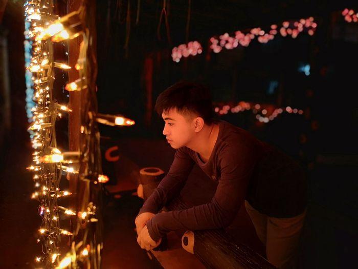 Man looking at illuminated christmas lights