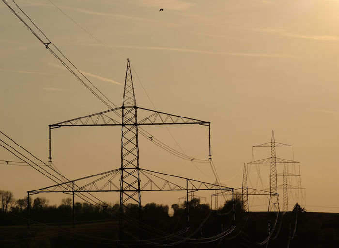 Electricity Pylon Against Sky At Sunset