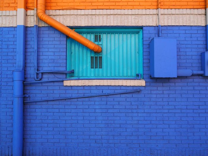 Blue Architecture Built Structure Wall - Building Feature Building Exterior No People Day Hygiene Wall Outdoors Brick Wall Brick Pattern Pipe - Tube Wood - Material Equipment Gardening Equipment Broom House Garage Orange Color