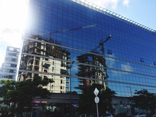 The buildings of tomorrow Reflection Glass Architecture Built Structure Building Exterior Outdoors Day Low Angle View Sky No People Modern City The Graphic City