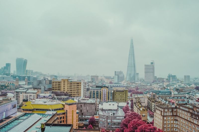 Cityscape By Shard Against Sky During Foggy Weather
