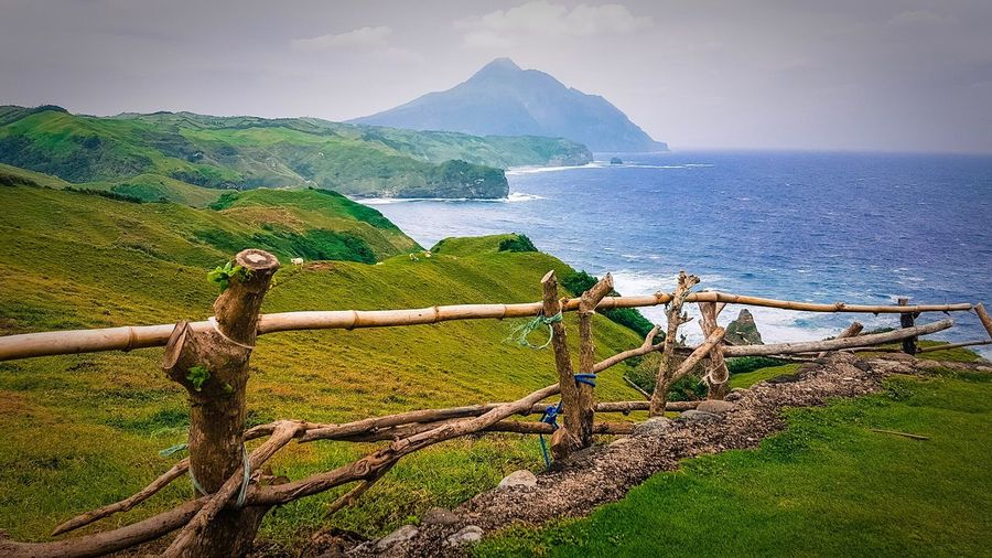 batanes Sea Beauty In Nature Mountain Scenics Nature Outdoors Tranquil Scene Water Tranquility Green Color Sky No People Day Beach Horizon Over Water Nautical Vessel