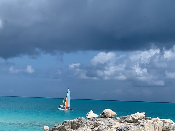 Water Sky Sea Cloud - Sky Beauty In Nature Beach Scenics - Nature Nature Land Nautical Vessel Day Tranquil Scene Tranquility Holiday Outdoors Travel Vacations Idyllic Horizon Over Water Sailboat