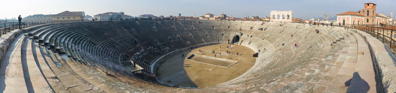 Panoramic view of historic amphitheater against sky at veneto