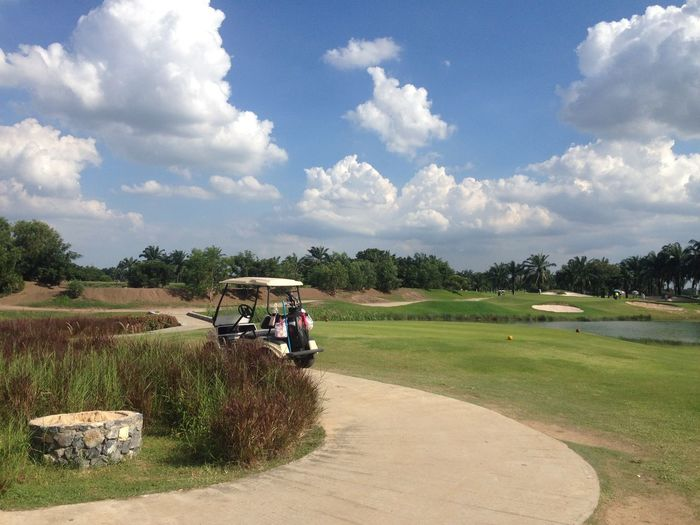 Golf Cart On Course Against Sky