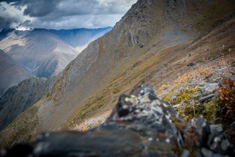 High alpine riding in Tusheti Nationalpark Mountain Rock Solid Rock - Object Mountain Range Landscape Beauty In Nature Day Nature Scenics - Nature Cloud - Sky Environment Land Sky No People Outdoors Tranquility Mountain Peak Valley Non-urban Scene Lichen Formation Mountain Biking