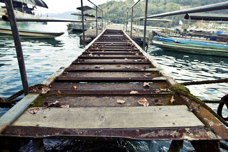 Adventure Beauty In Nature Boardwalk Day Dock Nature Nautical Vessel No People Outdoors Pier Sky The Way Forward Travel Water