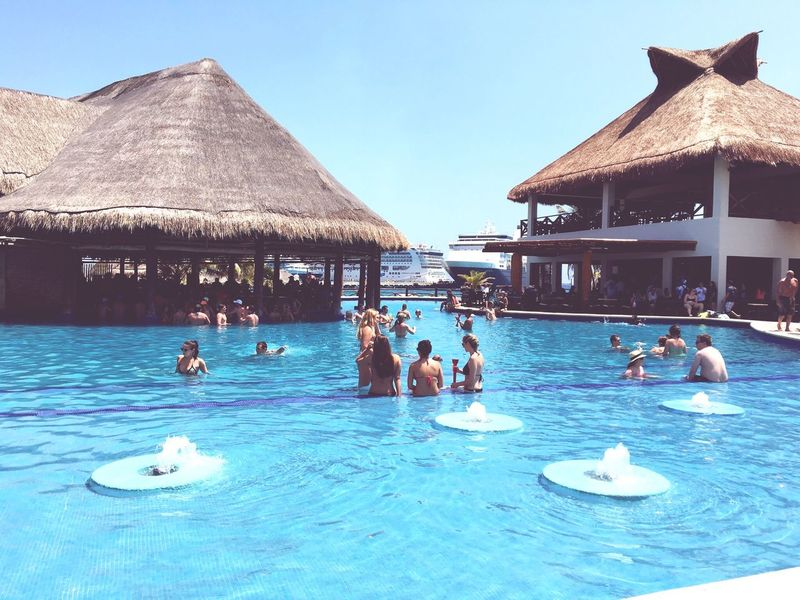 Pool Swimming Pool Swimming Water Summer Building Exterior Outdoors Day Nature Cruise Mexico Real People Blue Beauty Happiness Lifestyles Pretty Sunlight Picture Beach