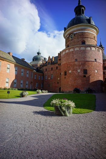 Clock Tower Castle in Sweden Architecture Building Exterior Built Structure Sky Cloud - Sky Building Nature Plant No People The Past History Day Tower Travel Destinations Direction Outdoors Grass The Way Forward Footpath Sunlight Spire  Castle Clock Tower