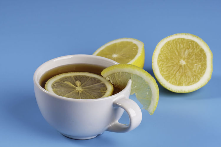 Close-up of tea cup against blue background