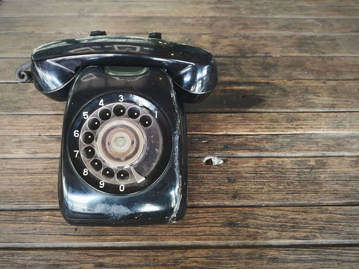 High angle view of old telephone on table