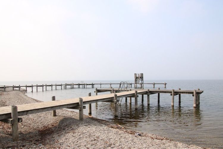 Wooden Piers On Lakeshore
