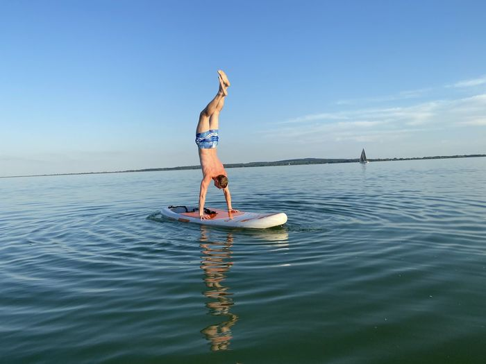Handstand on the paddle board