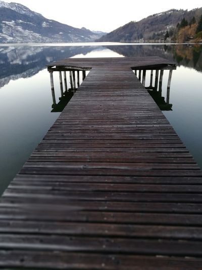 Pier Lake Landscape Water Scenics Jetty Beauty In Nature Silence Tranquility Nature Environment Mountain Tourism Wood - Material Tranquil Scene Outdoors No People Travel Destinations