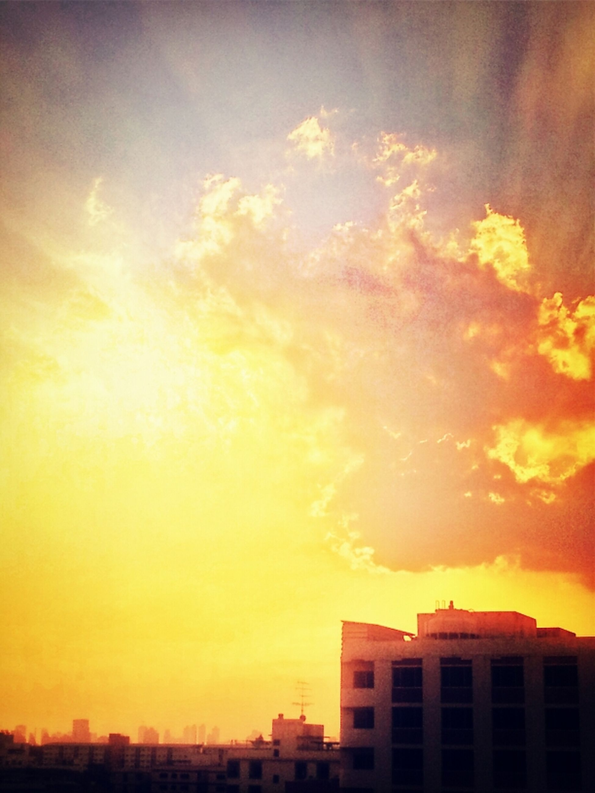 sunset, building exterior, architecture, built structure, orange color, sky, city, sun, cloud - sky, residential building, residential structure, silhouette, low angle view, building, sunlight, house, beauty in nature, outdoors, nature, yellow