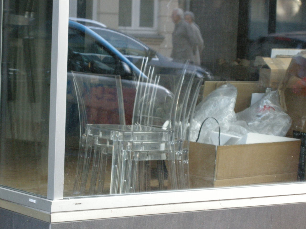 glass - material, transparent, window, reflection, transportation, real people, day, outdoors, one person, architecture, building exterior, close-up, people
