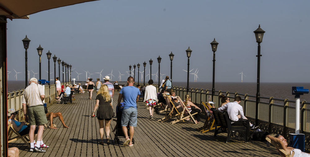 Adult Clear Sky Day Full Length Large Group Of People Last Sunny Days Leisure Activity Lifestyles Men Nature Outdoors People Railing Real People Sea Sky Walking Water Women