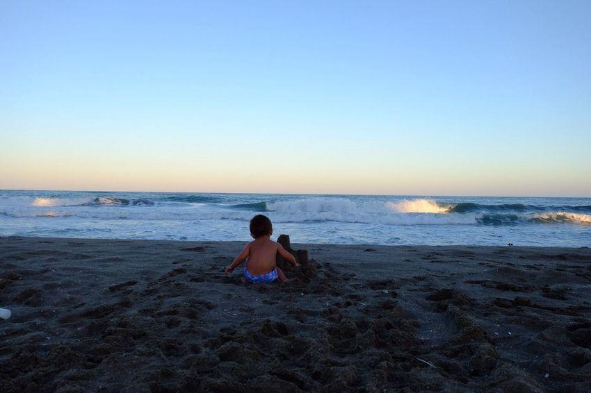 The child, the sand and the sunset. Child Photo Sunset Beach Summer Photography Photoart EyeEm Best Shots EyeEm Gallery Fujifilm Eye4photography  EyeEm Traveling CostadelSol Light And Shadow Light Mediterranean