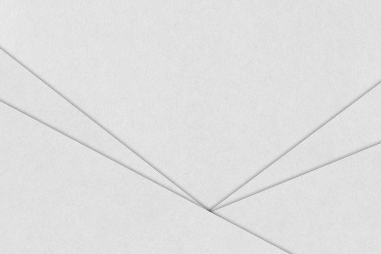 High angle view of paper over white background