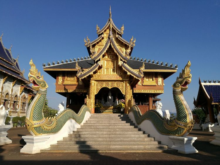 Naga in the temple with sunset. Tourism Religion Travel Sky Arrival Architecture No People Outdoors Day naga Beauty In Nature Clear Sky Sculpture Architecture History Travel Destinations Building Exterior Arts Culture And Entertainment Gold Pagoda Landscape Gold Colored Built Structure Blue Statue
