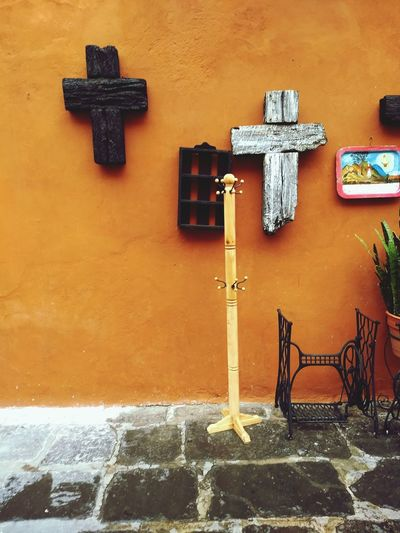 Cross on wall against building
