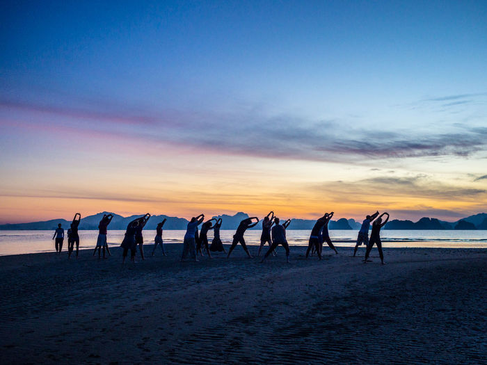 Taichi on a beach at sunrise Beach Horizon Over Water Large Group Of People Lifestyles Outdoors Real People Scenics Sea Silhouette Sky Sunrise On A Beach Thailan Taichi Taichi At Sunrise On The Beach Taichi On The Beach Togetherness Tranquility