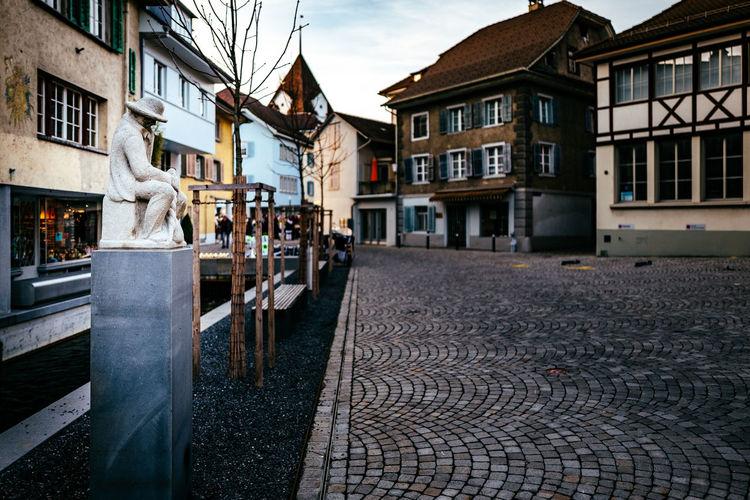 Statue on sidewalk in town