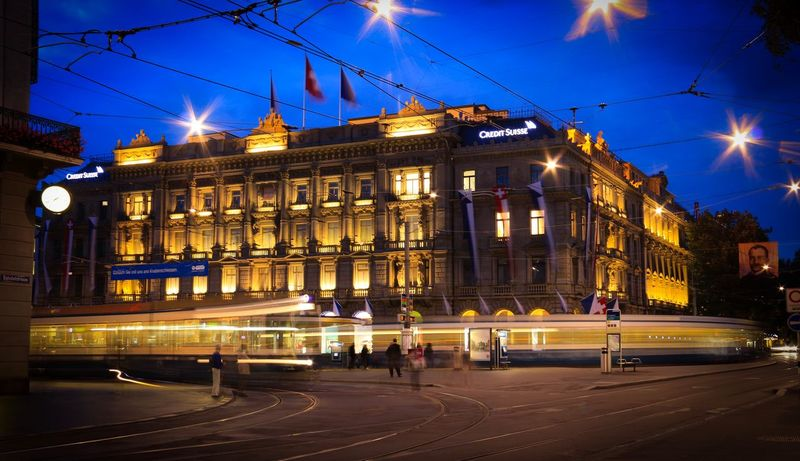 Paradeplatz and The Trams Bahnhofstrasse Blurred Motion Movement Tramway City Center Heritage Plaza Public Transportation Tram Blue Hour Architecture Night Illuminated Building Exterior Built Structure City Street Light Sky Outdoors Travel Destinations People
