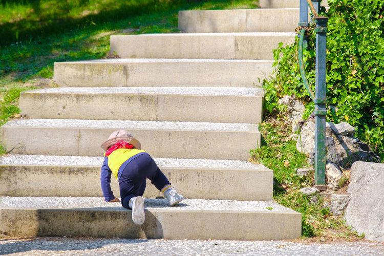 Newborn baby climb stairs